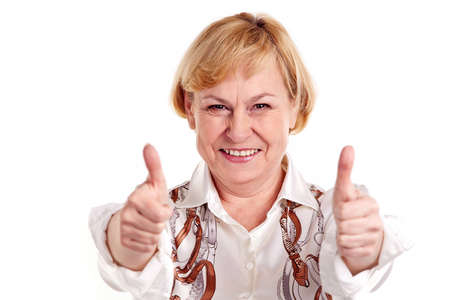 Happy mature woman showing thumbs up sign photo