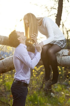 Young couple going to kiss in park photo