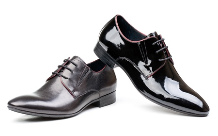 patent leather: Two black men shoes against white Stock Photo