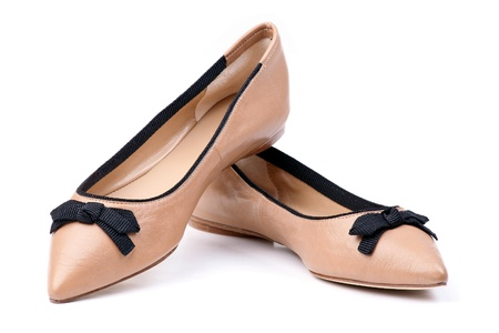 Pair of beige female shoes over white Stock Photo - 12798112