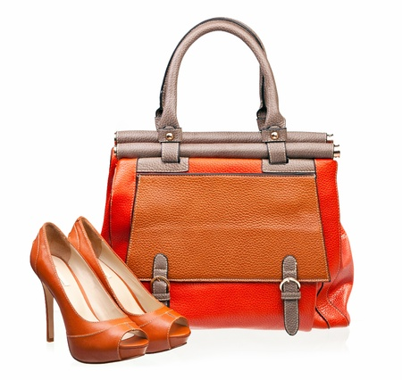 closeup on bags: Pair of open-toe female shoes and handbag Stock Photo