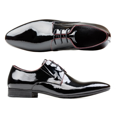 formal clothes:  Black patent leather men shoes against white