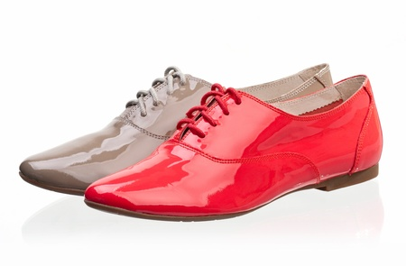 Patent leather women shoes against white photo