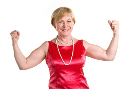 muscle woman: Portrait of fit senior woman flexing her biceps Stock Photo
