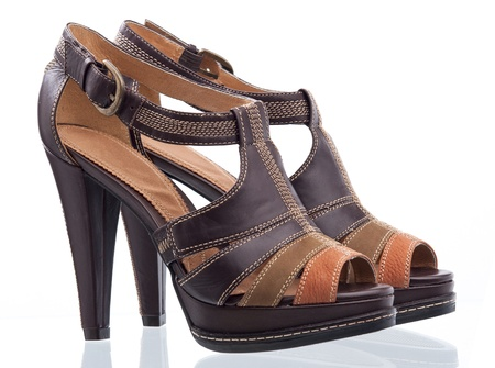 heel strap: Pair of fashion sandals isolated over white
