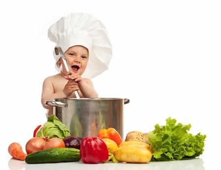 stirring: Little boy in chef s hat