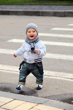 Little boy crossing a street photo