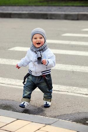 Little boy crossing a street