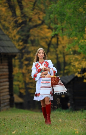Beautiful young woman in Ukrainian costume photo