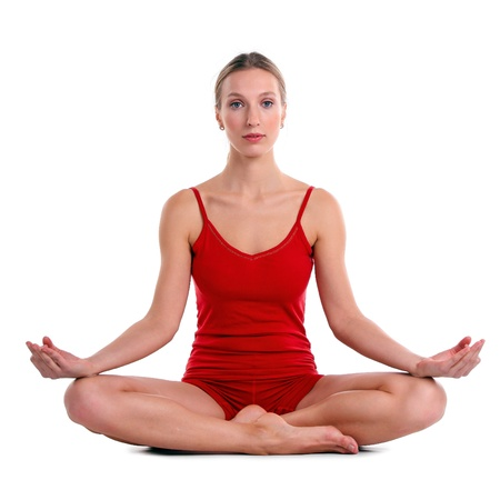 cross leg: Young woman practicing yoga in the lotus position, isolated over white  Stock Photo