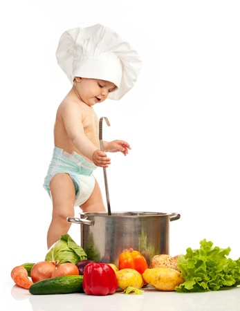 stirring: Little boy with ladle, casserole, and vegetables