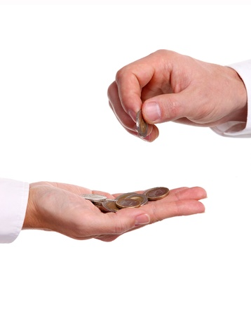 Male hand giving a euro coin to another person photo