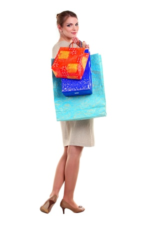Pretty young woman carrying shopping bags Stock Photo - 14024875