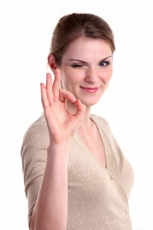 ok sign: Beautiful young woman giving ok sign and winking Stock Photo