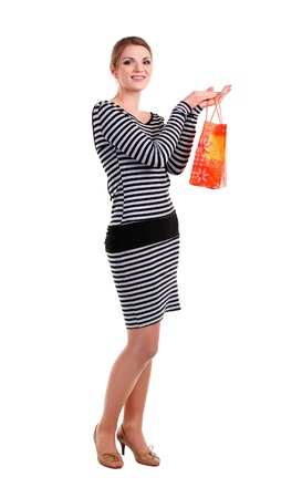 Pretty young woman with shopping bag over white photo