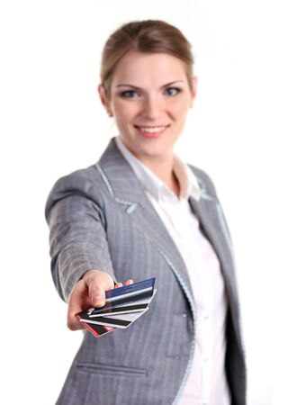 gray suit: Young businesswoman holding plastic cards