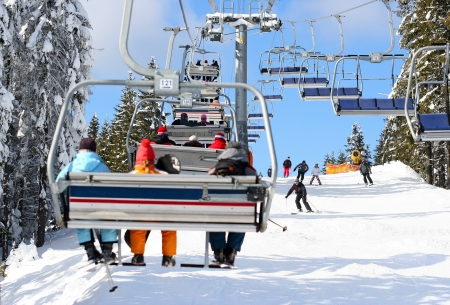 ski track: Skiers go on the lift on mountain in Bukovel, Ukraine Stock Photo