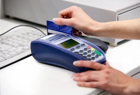Moment of payment with a credit card through terminal  photo