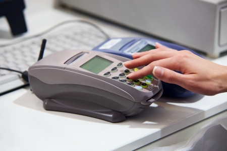 Paying with credit card through terminal  Stock Photo