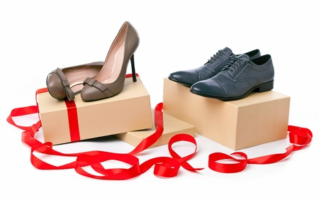 Female and male shoes on boxes with ribbon  photo