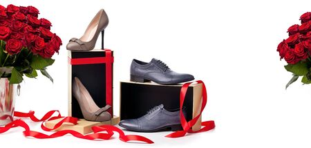 Female and male shoes on gift boxes and bunch of roses over white background  photo