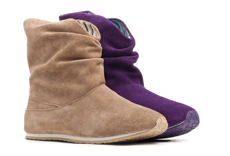 chamois leather: Two female boots  beige and violet ones over white background