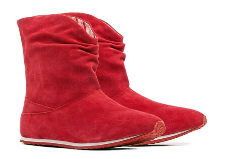 Pair of red female boots on the white background  Stock Photo