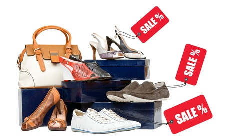 Shoes and handbag on boxes, sale tags attached to shoes  Stock Photo