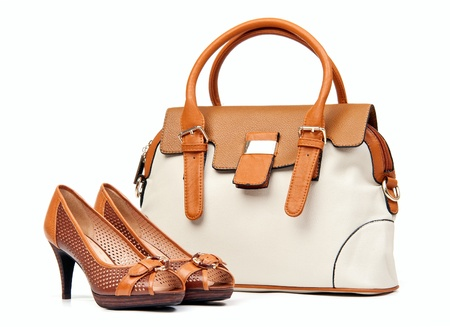 open toe: Pair of female shoes and handbag over white