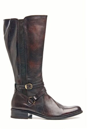 Brown female knee high boot over white  photo