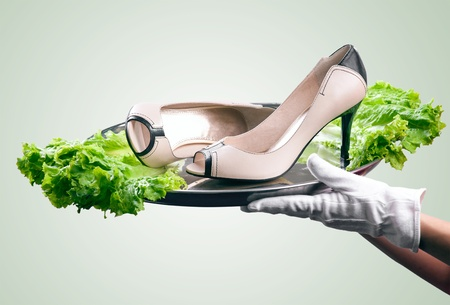 Waiter s hands holding tray with pair of female shoes decorated with lettuce  Concept of fresh product immediately delivered to customer Stock Photo - 16952920