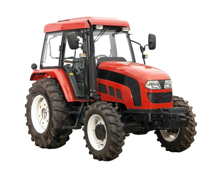 wheel tractor: New red tractor isolated over white background  With clipping path