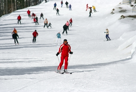 ski track: Female skier skiing down a wide track for beginners