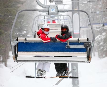 ski lift: Skiers on a ski-lift  Stock Photo