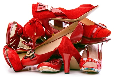 glitzy: Pile of female red shoes isolated on white background