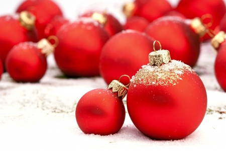 group of christmas baubles: Red Christmas baubles on snow