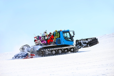 Ratrack taking skiers to top of mountain  photo