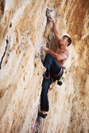 lead rope: Rock climber on a face of a cliff