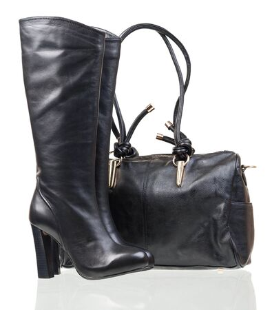 high heels shoes: Women high-heeled boots and leather bag over white