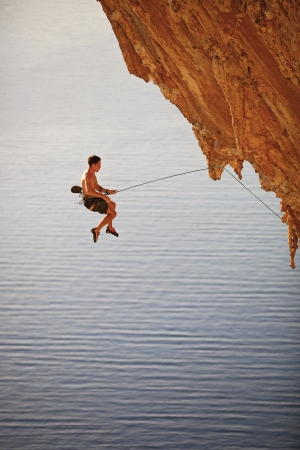 lead rope: Rock climber falling of a cliff while lead climbing