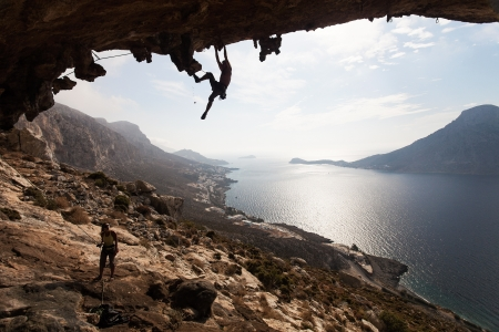 climbing sport: Rock climber climbing at the rock , Kalymnos Island, Greece Stock Photo