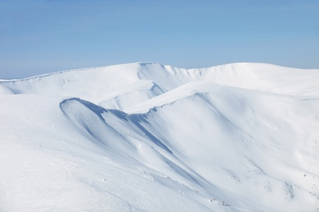 snowy mountain: Mountains slopes covered with snow  Stock Photo