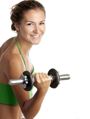 Leuk fitness meisje uit te werken met halters op witte achtergrond Stockfoto