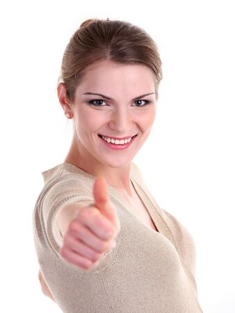 Beautiful young woman smiling brightly and showing thumb up sign photo