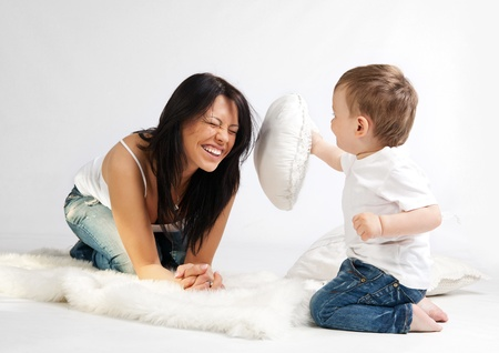 Young beautiful woman and her son having fun together  photo