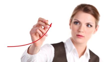Young business woman drawing an arrow with red pencil  photo