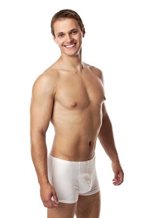 nackter junge: Gut aussehender junger Mann in Unterwäsche vor weißem Hintergrund Lizenzfreie Bilder
