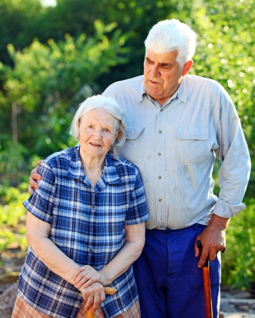Portrait of a mature man and his senior mother outdoor photo