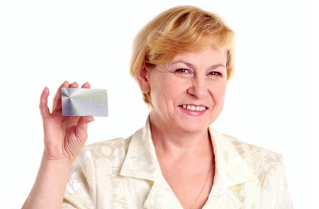 Successful mature businesswoman holding credit card  photo