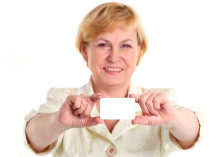 Smiling mature businesswoman holding blank empty business card or plastic card  photo